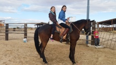 Horseback riding at ranch with cousin